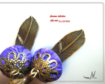 fine and elegant earrings in purple cotton fabric and feather