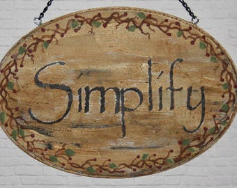 Primitive sign ~ Simplify ~ with vines and berries.