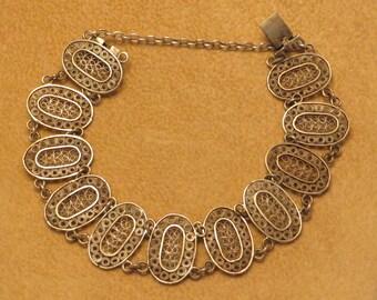 Lovely Vintage Art Deco era 800 silver filigree panel bracelet