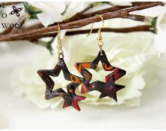 Earrings openwork star orange & Black