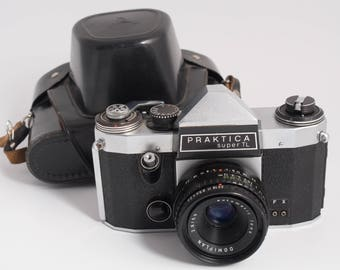Praktica super TL with lens Domiplan 50mm f2.8, M42 vintage camera from DDR