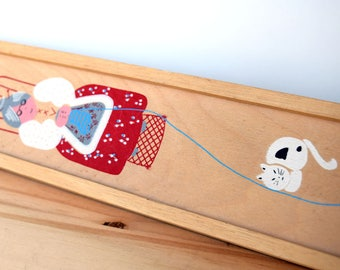 VIntage knitting needle case, wooden storage container with a picture of an old lady knitting with a cat and a window