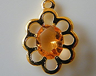 Charm pendant in gold tone, orange Crystal, 13 x 17 mm at the FT
