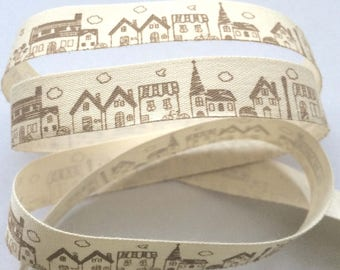"""decorative Ribbon: """"home and village"""" Brown on ecru background"""