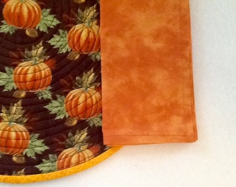 Pumpkins on Brown circular quilted placemats.  Fall placemats.  Thanksgiving placemats.