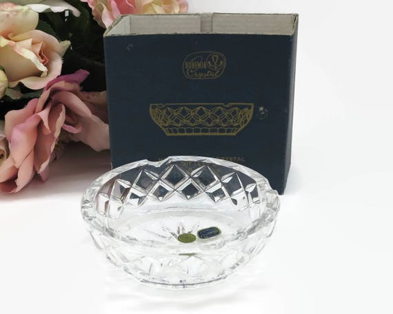 Crystal ashtray, hand cut lead crystal in diamond pattern and star burst pattern, made in Slovakia, original stickers and part of box, 1950s