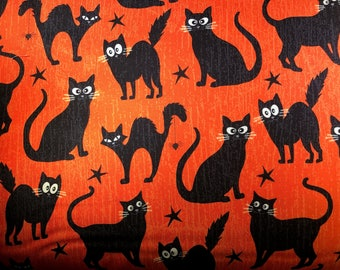 Black cats Halloween fabric with eyes that grow in the dark