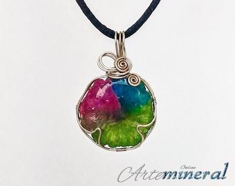 Multicolored mineral pendant set in silver thread.
