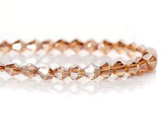 10 glass bicone beads 4 mm faceted champagne