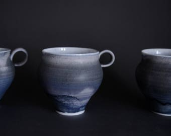 Tea/coffee cup with miracle blue crystalline glaze, handmade wheel thrown porcelain, elegant and minimalist