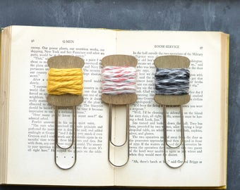 Jumbo Paper Clips. Spool of Yarn.