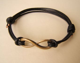 Bronze Infinity symbol bracelet, adjustable, black leather, surfer style. Friendship, love bracelet  Handmade.  Antique Bronze  tone.