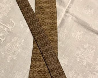 Hermes Paris, Hermes for Lotus, limited edition, vintage tie Twill 100% silk, folded by hand, Brown and beige, ref 874 PA.
