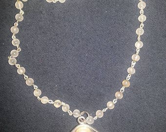 012# Shell with pearl necklace