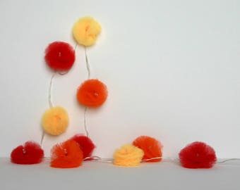 10 Led - Light Garland with pom poms in yellow, orange and Red tulle