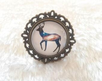 Blue reindeer round bronze ring