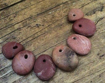 Drilled beach stones, beach stone beads, top drilled sea stone pendants.