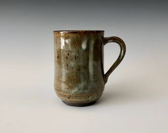 Modern large 12 oz handmade pottery coffee/tea cup earth tones with blue highlights Haight Pottery Company