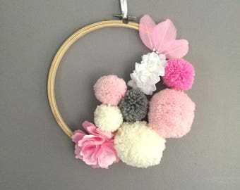 Wall hanging pom poms and fabric flowers
