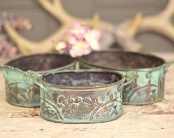 vintage embossed copper small oval planter set, verdigris finish, three oval storage containers.