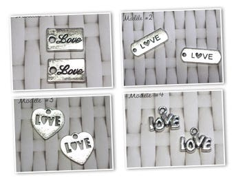 silver metal LOVE 2 tags