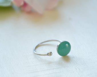 Resin lagoon and platinum silver plated brass twisted ring