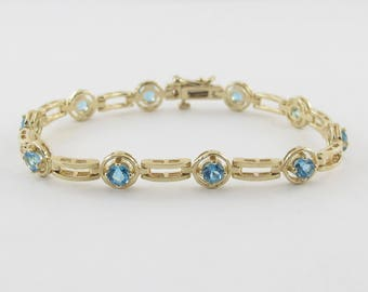 "14k Yellow Gold Gemstone Blue Topaz Tennis Bracelet 6 7/8"""