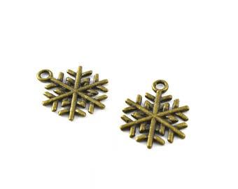 Set of 2 bronze colored metal snowflake charms *.