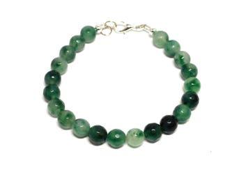 Bracelet natural green faceted beads