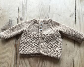 Baby hand-knitted cardigan in Alpaca wool