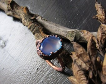 copper ring with milky blue bead