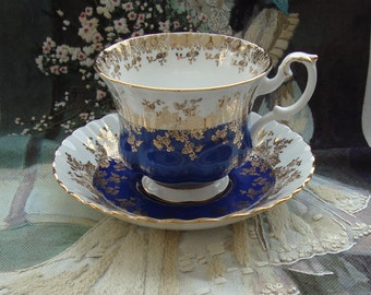 """Royal Albert - Regal Series """"Blue"""" - Bone China England - Vintage Tea Cup and Saucer - Blue Band with Gold Scroll and Trim"""