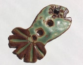 Large,  fun & funky, fish-shaped, green and rust 2.25-inch-long handmade stoneware ceramic button