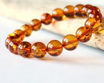 Golden amber bracelet, cognac color rouud amber beads, amber jewelry, natural Baltic amber, gemstone bracelet, amber jewellery 10.8 g.