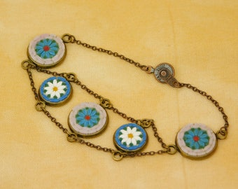 Micro mosaic bracelet - white and blue daisies on pink and blue background