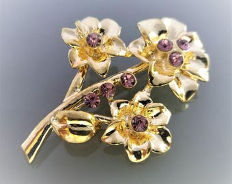 Metal brooch gold color and purple strass