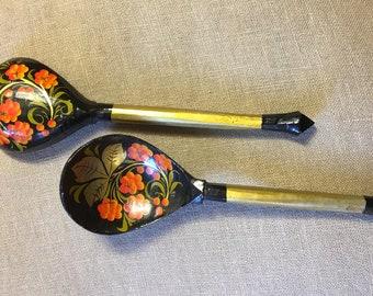 Vintage khokhloma wooden spoon with folk motif