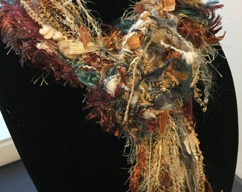 Mixed fibers and fall colors, fringed and unique Scarf/Lariat!