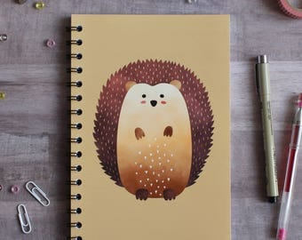 NOTEBOOK. A5 Cute Hedgehog Spiral Notebook. Soft 300 gsm Card Cover. 120 lined pages. Matte lamination pleasant to the touch.