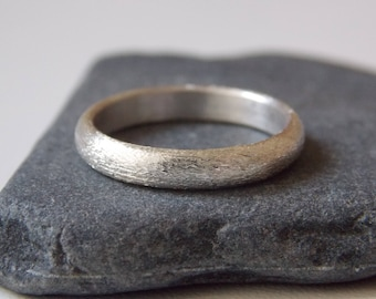 silver fine ring with a sandblaster effect.