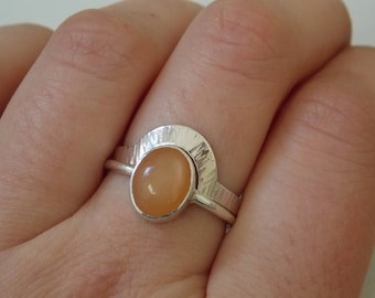 silver stacking rings with a orange moonstone