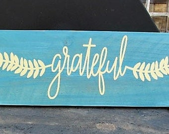 """Rustic sign, """"Grateful"""" wall decor, 17"""" x 5.5"""" aqua with accent colors: white, blue, green. Words are Cream (Buttery White) distressed wood."""