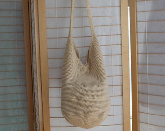 The Sak bag Style 120! Cream colored crocheted summer bag with long strap . Great Vintage 90s style.