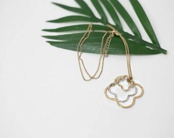 Triple quatrefoil necklace