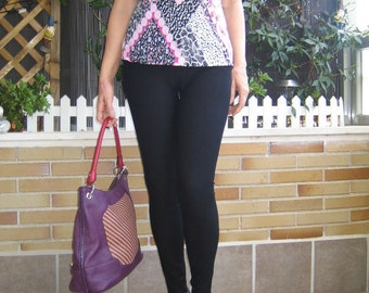 Top in pink and black tones top with cut on the chest and knotted at the back top tied to the neck top fitted top with different color