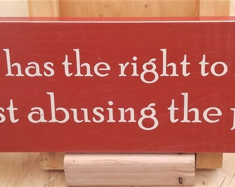 Everyone has the right to be stupid, you're just abusing the privilege wooden sign