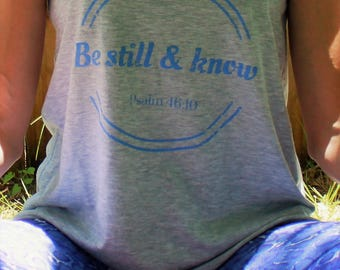 BE STILL & KNOW heathered light gray tank with cornflower blue graphic