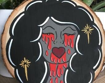 Pretty lady dripping blood