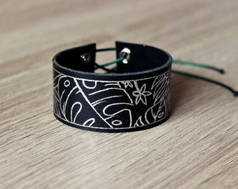 black leather bracelet with silver drawing