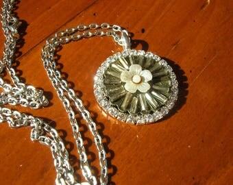 An Antique Wagon wheel silver pendant